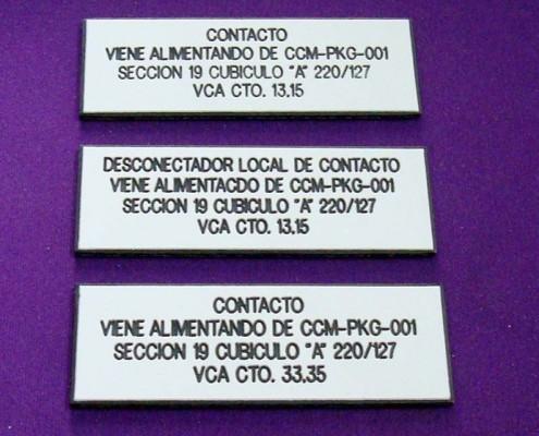 CONTACTO - Placas grabadas y biseladas en gravoply, bajo relieve a base de pantógrafo.